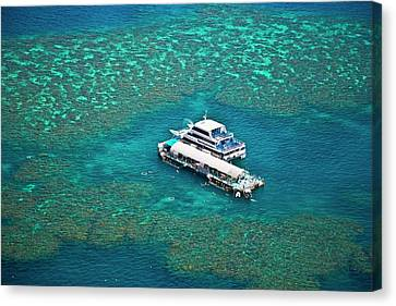 Aerial View Of A Tour Boat Docked Canvas Print by Miva Stock