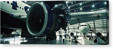 Airplanes In A Hangar, Mirabel Airport Canvas Print by Panoramic Images