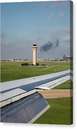 Airport Control Tower And Airplane Wing Canvas Print by Jim West