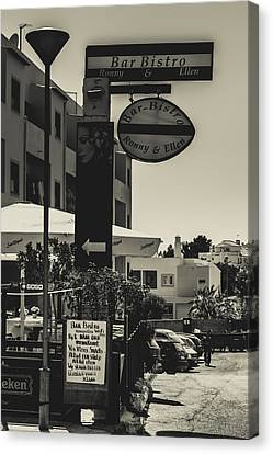 Albufeira Street Series - Bar Bistro Canvas Print by Marco Oliveira