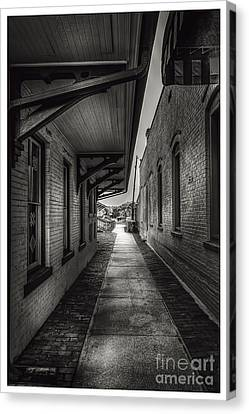 Alley To The Trains Canvas Print by Marvin Spates
