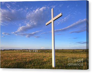 Alone At The Cross Canvas Print by Dan Jurak