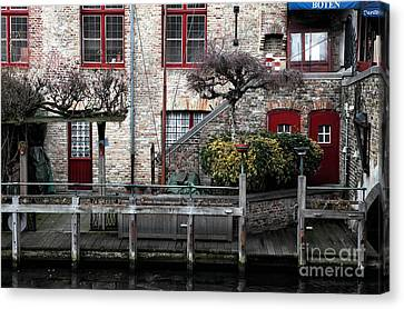Along The Canal Canvas Print by John Rizzuto