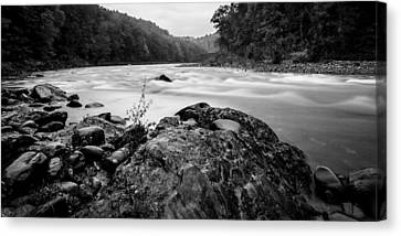 Along The River Canvas Print by Adam Caron