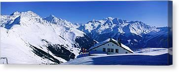 Alpine Scene In Winter, Switzerland Canvas Print by Panoramic Images