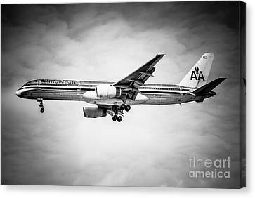 Amercian Airlines Airplane In Black And White Canvas Print by Paul Velgos
