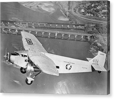 American Airlines Tri-motor Canvas Print by Henri Bersoux
