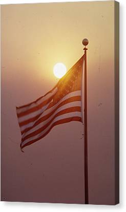 American Flag Flying High Canvas Print by Retro Images Archive