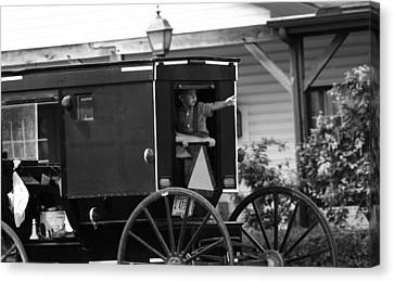 Amish Boy Waving In Horse And Buggy Canvas Print by Dan Sproul