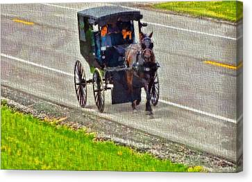 Amish Family In Horse And Buggy Canvas Print by Dan Sproul