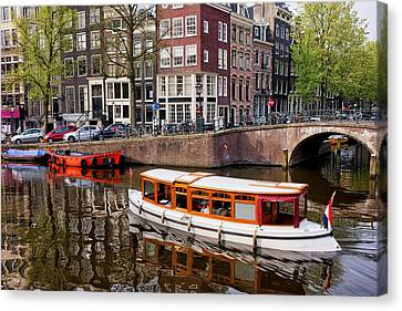 Amsterdam Canal And Houses Canvas Print by Artur Bogacki