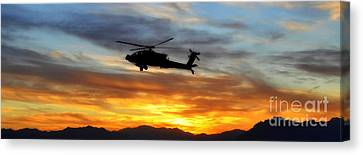 An Ah-64 Apache Canvas Print by Paul Fearn