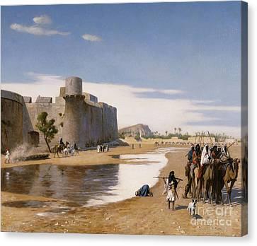 An Arab Caravan Outside A Fortified Town Canvas Print by Jean Leon Gerome