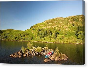 An Inflatable Kayak On Ullswater Canvas Print by Ashley Cooper