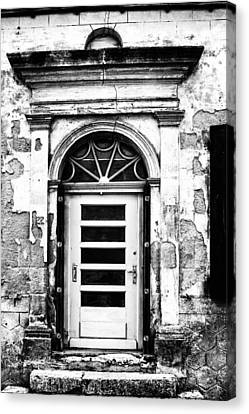 An Intriguing Door In Black And White Canvas Print by Georgia Fowler