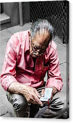 An Old Man Reading His Book Canvas Print by Sotiris Filippou