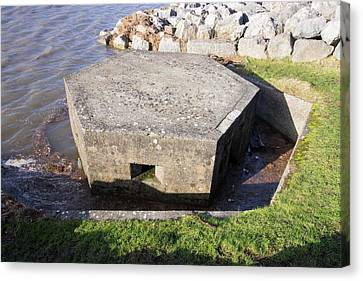 An Old World War Two Pill Box Flooded Canvas Print by Ashley Cooper