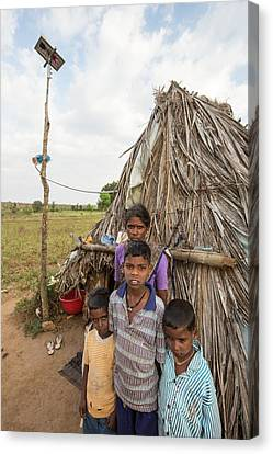 An Untouchable Family Outside Their Hut Canvas Print by Ashley Cooper
