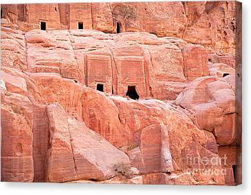 Ancient Buildings In Petra Canvas Print by Jane Rix