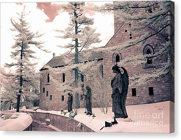 Angels And Religious Statues Winter Churchyard - Angel Statues With Jesus Churchyard Winter Scene Canvas Print by Kathy Fornal