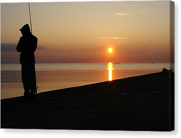 Angler Of The Pier Canvas Print by Gynt