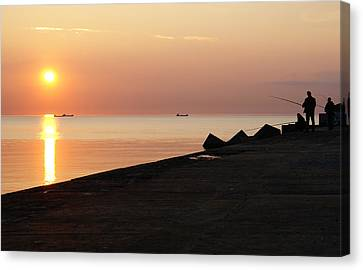 Anglers On The Pier Canvas Print by Gynt
