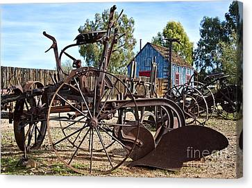 Antique Farm Equipment End Of Row Canvas Print by Lee Craig