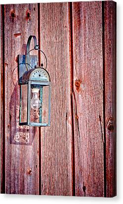 Antique Lantern On Weathered Red Barn Canvas Print by Jeff Sinon