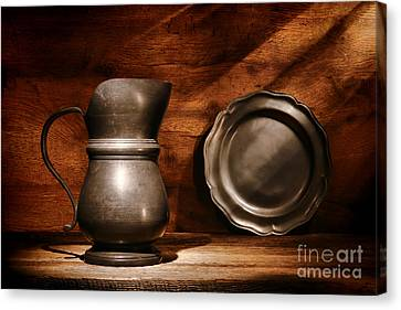 Antique Pewter Pitcher And Plate Canvas Print by Olivier Le Queinec