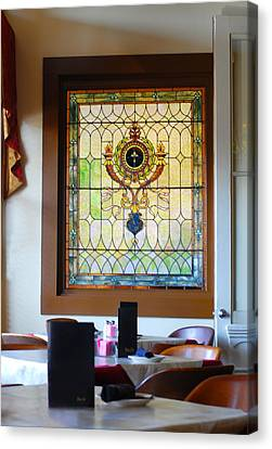 Antique Stained Glass Window At The Ant Street Inn Canvas Print by Connie Fox