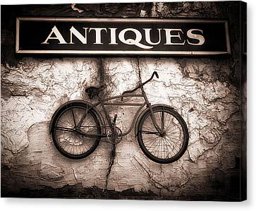 Antiques And The Old Bike Canvas Print by Bob Orsillo