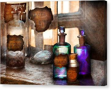 Apothecary - Oleum Rosmarini  Canvas Print by Mike Savad