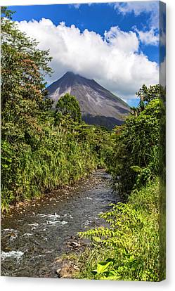 Arenal From The Rio Agua Caliente Canvas Print by Andres Leon