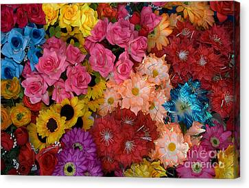 Artificial Flowers At An Acapulco Market Canvas Print by Ron Sanford