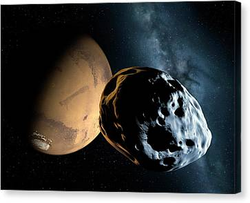 Asteroid Approaching Mars Canvas Print by Detlev Van Ravenswaay