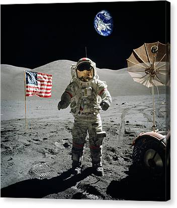 Astronaut On The Lunar Surface Earth On The Background Canvas Print by Celestial Images