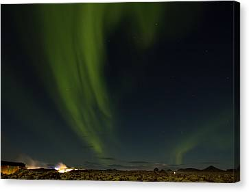 Aurora Borealis Over Iceland Canvas Print by Andres Leon