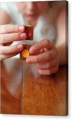 Autistic Girl Playing With Toy Blocks Canvas Print by Hannah Gal