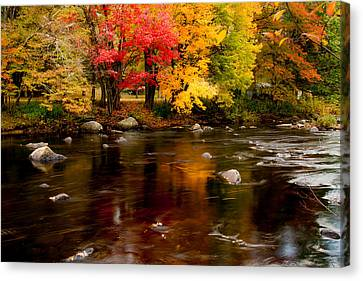 Autumn Colors Reflected Canvas Print by Jeff Folger