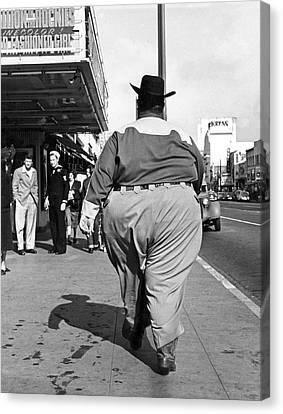 Backside Of Hefty Cowboy Canvas Print by -