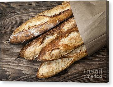 Baguettes Bread Canvas Print by Elena Elisseeva