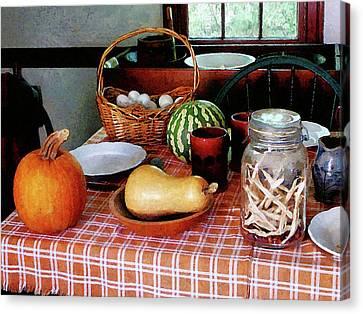 Baking A Squash And Pumpkin Pie Canvas Print by Susan Savad