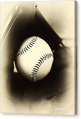 Ball In Glove Canvas Print by John Rizzuto