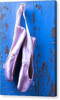 Ballet Shoes On Blue Wall Canvas Print by Garry Gay