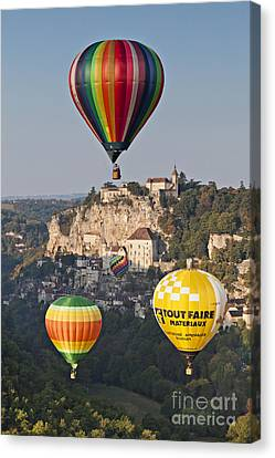 Balloons At Rocamadour Midi Pyrenees France Canvas Print by Colin and Linda McKie
