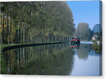 Barge On Burgandy Canal Canvas Print by Carl Purcell