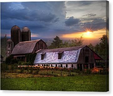 Barns At Sunset Canvas Print by Debra and Dave Vanderlaan