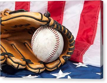 Baseball And Glove On American Flag Canvas Print by Joe Belanger