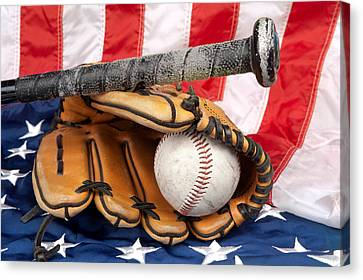 Baseball Equipment On American Flag Canvas Print by Joe Belanger