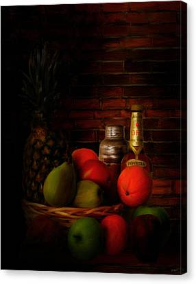 Basket Of Colors Canvas Print by Lourry Legarde
